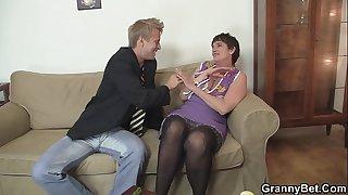 Old grandma in stockings is..
