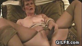 GILF Masturbating With Her..