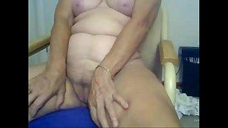 Horny granny fingering in..