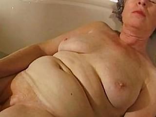 Granny masturbates with a..