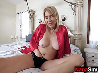 Granny fingers her pussy..