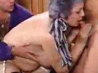 Hairy granny fucking two guys
