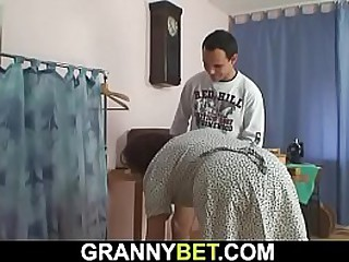 Sewing granny enjoys sucking..